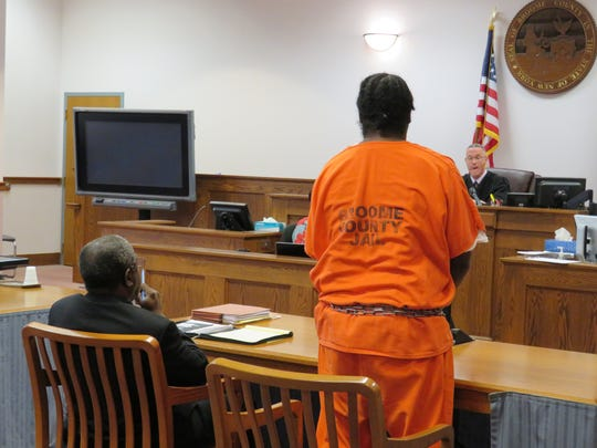Dwight Burton stands in the courtroom ahead of Judge
