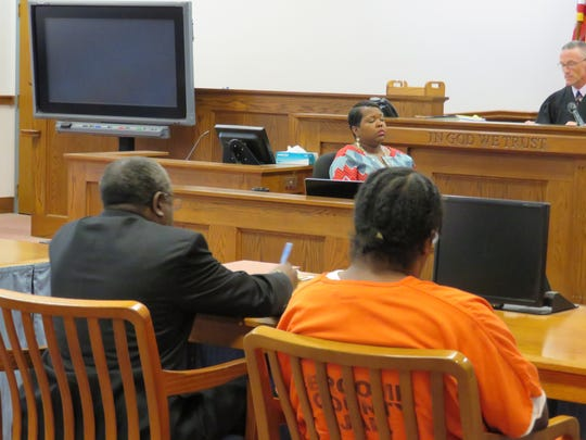 Dwight Burton sits with his defense lawyer Allen Stone