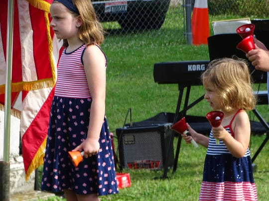 Members of the Community Children's Bell Choir perform the National Anthem to start the Frankfort Area Historical Society's 4th of July program Tuesday morning.