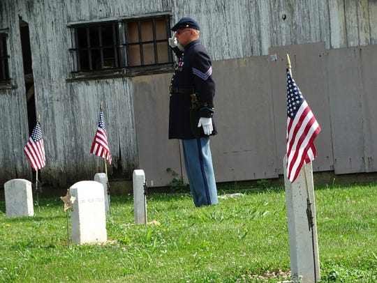 Flags were placed and salutes offered at the graves