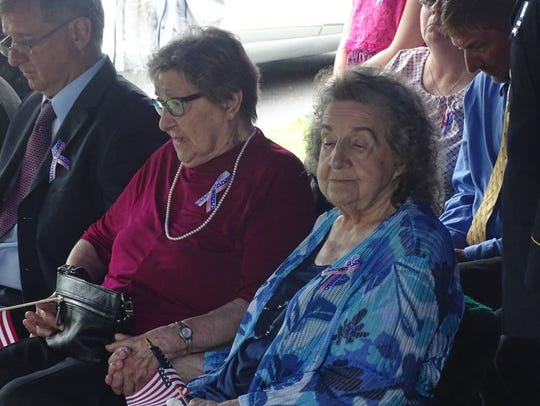 Sisters Ethel Smith, 86, and Mary Ocheske, 90, hold
