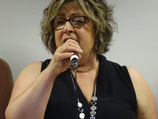"""Lisa Young of CB Singers sings """"So Many Stars"""" at the"""