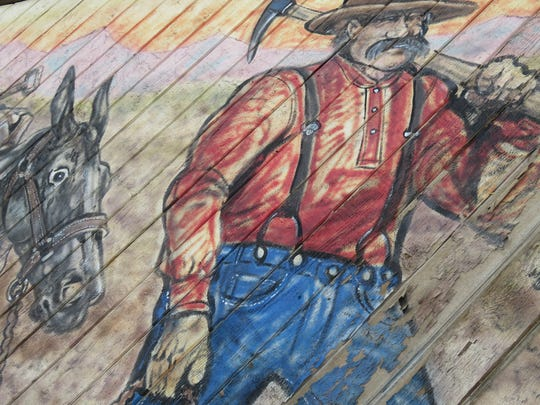 A mural in Elko depicts a miner and a mule.