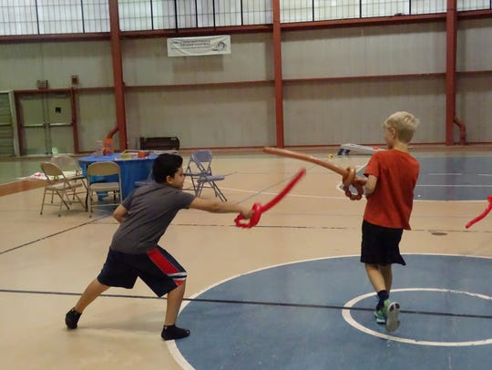 Ten-year-old Ilan Trejo, left, and Gabe Wensinger,