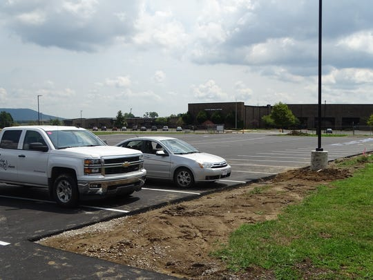 What was once a gravel parking lot by the football and softball fields has been paved to provide a better parking experience for both sports and in school events.