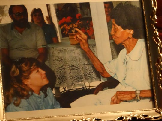 A treasured photograph of Georgiann Potts when she was teaching English 309: Louisiana Life and Literature at the University of Louisiana at Monroe (then Northeast Louisiana University). She is pictured here talking with the late Louisiana folk artist, Clementine Hunter, during a field trip to Natchitoches with her students.