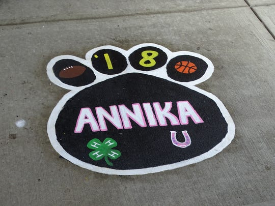 The courtyard filled with paw prints created by seniors to showcase some of their interests -- a Paint Valley tradition -- contains one painted by classmates in honor of Annika Miller, who was killed in a car crash during her junior year.