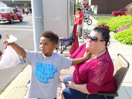 Tammy Jones and son Billy Jones wait for candy to be