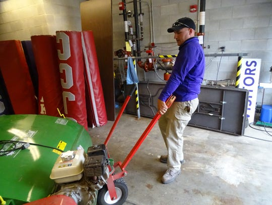 Fremont City Schools groundskeeper Cory Hull prepares