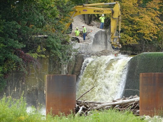 Workers started notching the Ballville Dam Wednesday, as the city prepares for the dam's ultimate demolition in 2018.