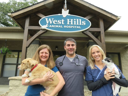 From left are Scout, Betsy Brent, Dr. Matthew Brent,