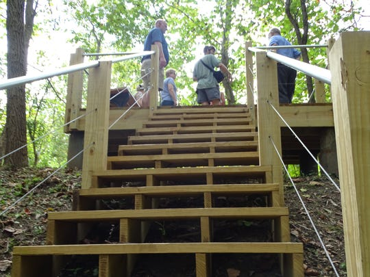 Visitors to the new Kinnikinnick Fen Nature Preserve made their way up these stairs Saturday to one of three observation decks overlooking wetland areas.