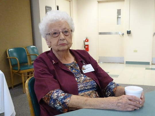 Myrtle Koch, 100, reminisces about volunteering at ProMedica Memorial Hospital as colleagues wish her a happy birthday.
