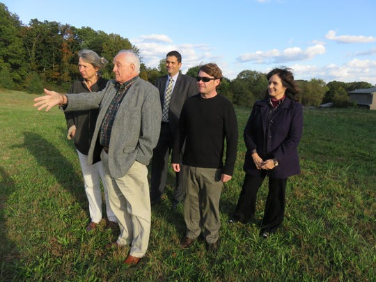 Mark Jendrek, second from left, discusses the Broome