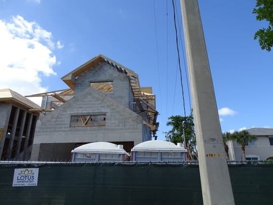 A construction worker suffered an electric shock while working at a Naples construction site off Park Street and fell about 25 feet, Thursday, Nov. 30, 2017.