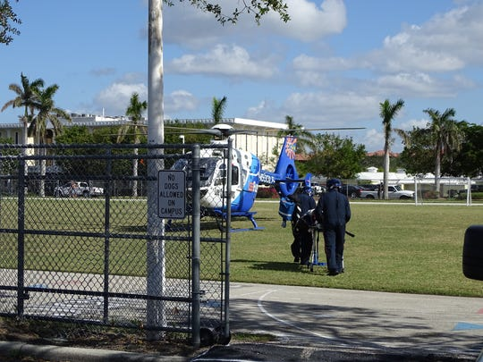A construction worker who suffered an electric shock while working at a Naples construction site off Park Street and fell about 25 feet is taken to a helicopter to be transported to Lee Memorial Hospital, Thursday, Nov. 30, 2017.