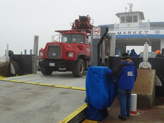 A construction vehicle departs from a Miller Boat Line ferry. Miller Boat Line announced plans to add a vessel to their fleet thanks to a growing demand for vehicle and passenger travel.