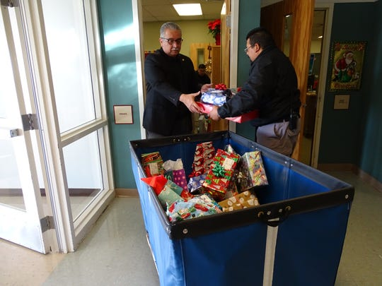 Otero County Prison Facility Warden Rick Martinez and staff delivered Christmas gifts to elementary schools in Chaparral on Thursday as part of the prison's Angel Tree program.