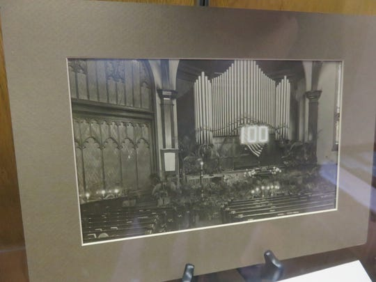 A photo on display shows former church nave during 100th anniversary in 1918.