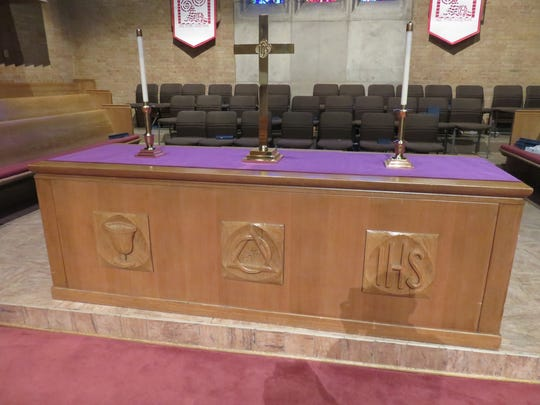 The wooden altar has a mid-century look.