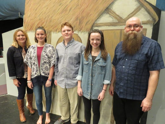 Standing next to a musical set produced by the Bearden Middle art department are director Toni Montross, Anne Eddins, Henry Densereau, Eliza Abernathy and musical director Scott Williams.