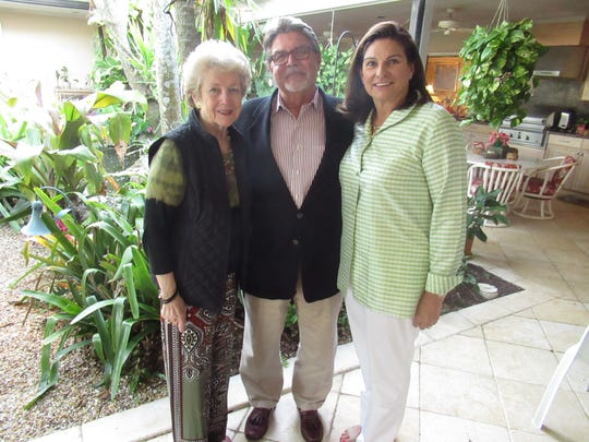 """Ann Marie McCrystal, left, Steve Scheivelbien and Karen Scheivelbien  at the  """"Cocktails and Conversation"""" event to discuss maternal and infant health throughout multiple continents."""