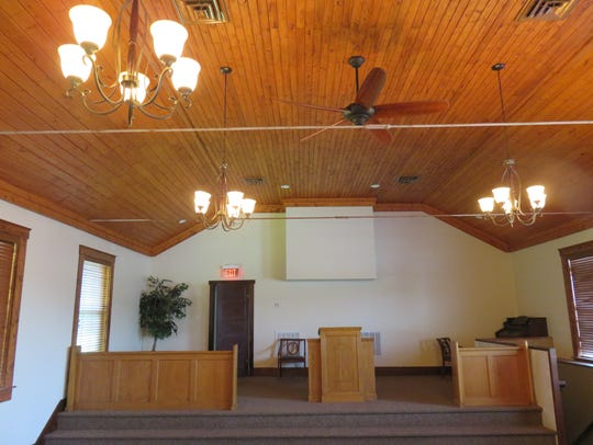 The chapel features a classic wooden ceiling.