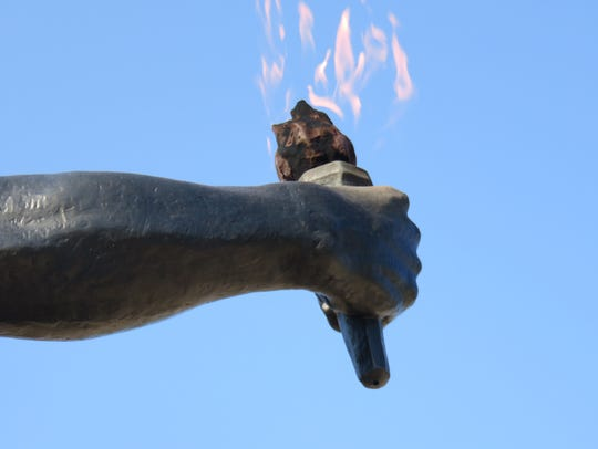 The arm of the bronze Torchbearer was once broken at