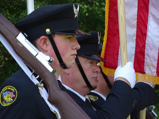 Members of Paint Valley High School's Cadet Corps, along with its adviser, Master Sgt. John Wilson, served as the color guard for a Memorial Day ceremony Monday at Floral Hills Memory Gardens just south of Chillicothe.