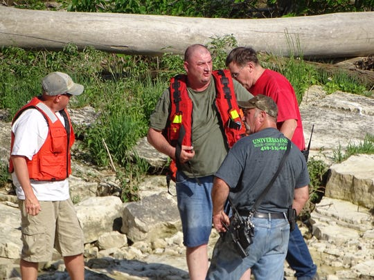 Members of the Ballville Volunteer Fire Department's Water Rescue team prepare to bring a distressed swimmer ashore Monday at the Sandusky River near the Ballville Dam.