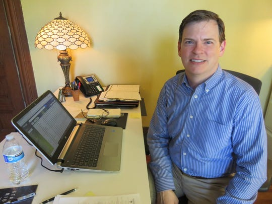 Knox Heritage executive director Todd Morgan inside his office at the historic Westwood mansion.