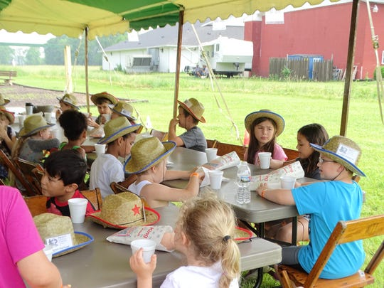 At Cowboy Camp, children do crafts and eat snacks as well as ride horses and shoot bows and arrows.