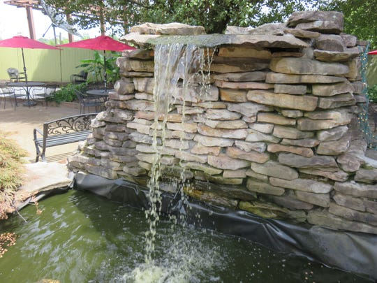 The outdoor courtyard at Merelli's features a rock waterfall.