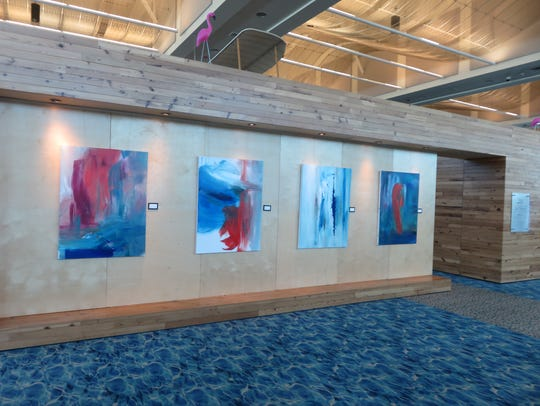 The outer wall of Skyport Gallery is home to four acrylic