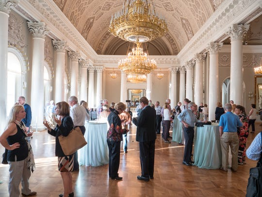 Tauck passengers attend a private reception at the