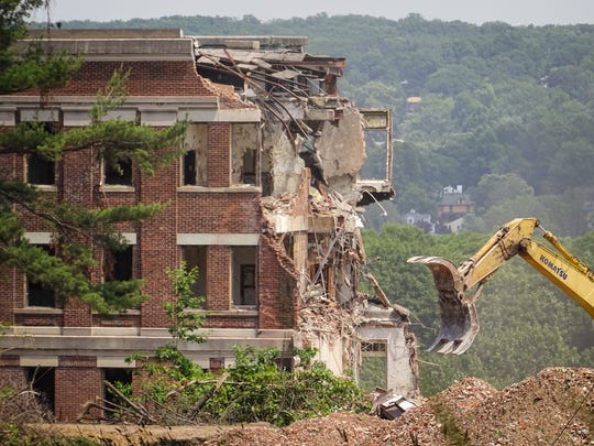 Dallas Contracting Co.'s Komatsu is about to take a bite out of Overbrook's Reception Building.