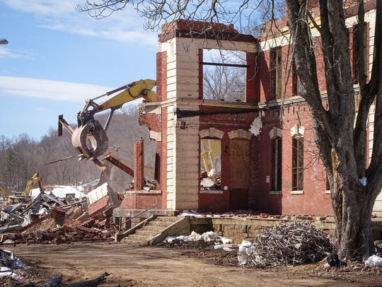The final demolition of Overbrook's Hill Building for male patients.