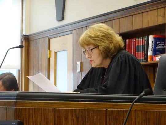 Visiting judge Patricia Cosgrove reads terms of Sean