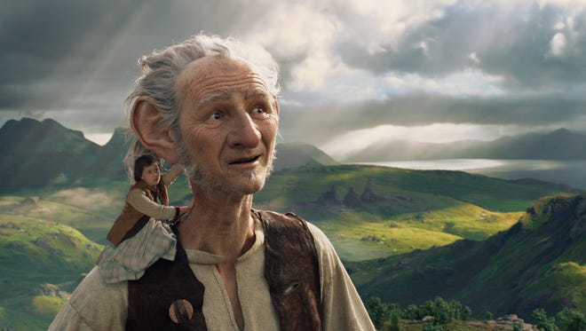 Sophie (Ruby Barnhill) looks at the sights of Giant Country with her big new friend (Mark Rylance) in 'The BFG.'