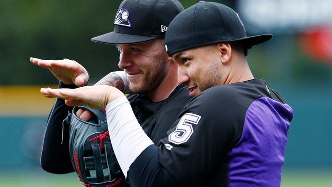 """Carlos Gonzalez, here mugging with Rockies shortstop Trevor Story, says he """"never lost faith"""" he'd rebound after a poor start."""