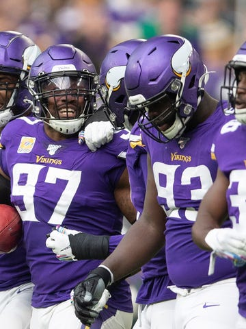 Minnesota Vikings defensive end Everson Griffen (97) celebrates his interception with teammates against the Philadelphia Eagles in the second quarter of an NFL football game, Sunday, Oct. 13, 2019, in Minneapolis. (Jerry Holt/Star Tribune via AP)
