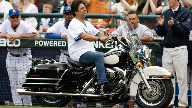 """Actor Erik Estrada, known for his role in television series"""" CHiPS"""" rides a police-type motorcycle past the Seattle Mariners dugout prior to throwing out the first pitch before the baseball game against the Oakland Athletics in Seattle, Sunday, July 29, 2007"""