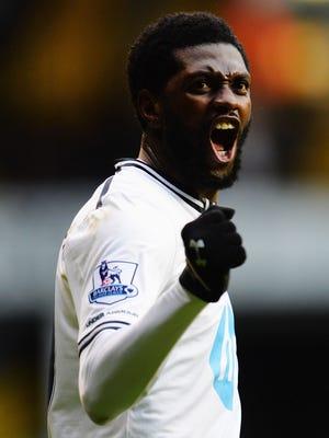 Emmanuel Adebayor celebrates scoring in Tottenham's game against Everton.