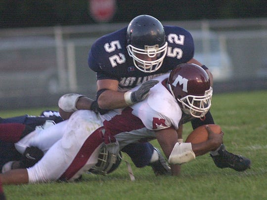 Marcus Calverley (52) was an LSJ Dream Team defensive tackle at East Lansing High as a senior in 2003 and also earned 2004 all-area honors in baseball as a senior.
