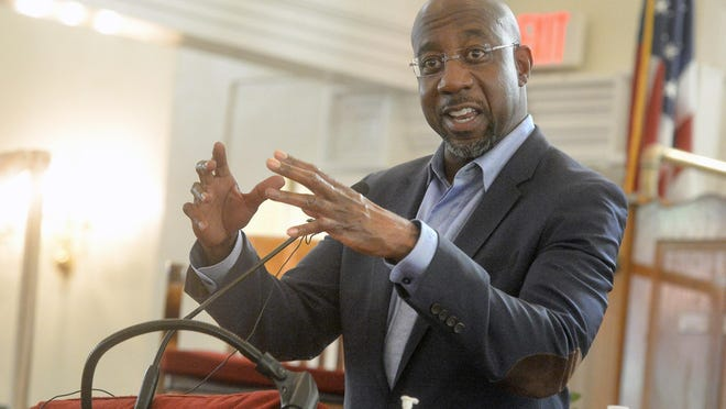 Rev. Raphael Warnock speaks to Savannah residents during a recent campaign tour.