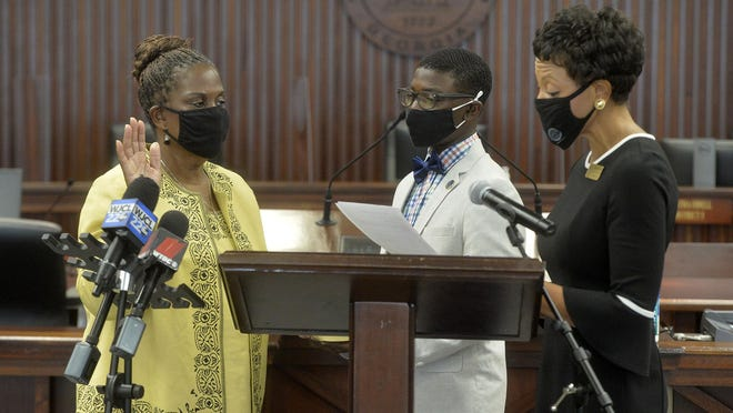 Chatham County Superior Court Clerk Tammie Mosley swears in Yvonne Holmes as Chatham County District 2 Commissioner on Thursday. Holmes will hold the seat until December after the passing of her husband James J. Holmes last month.
