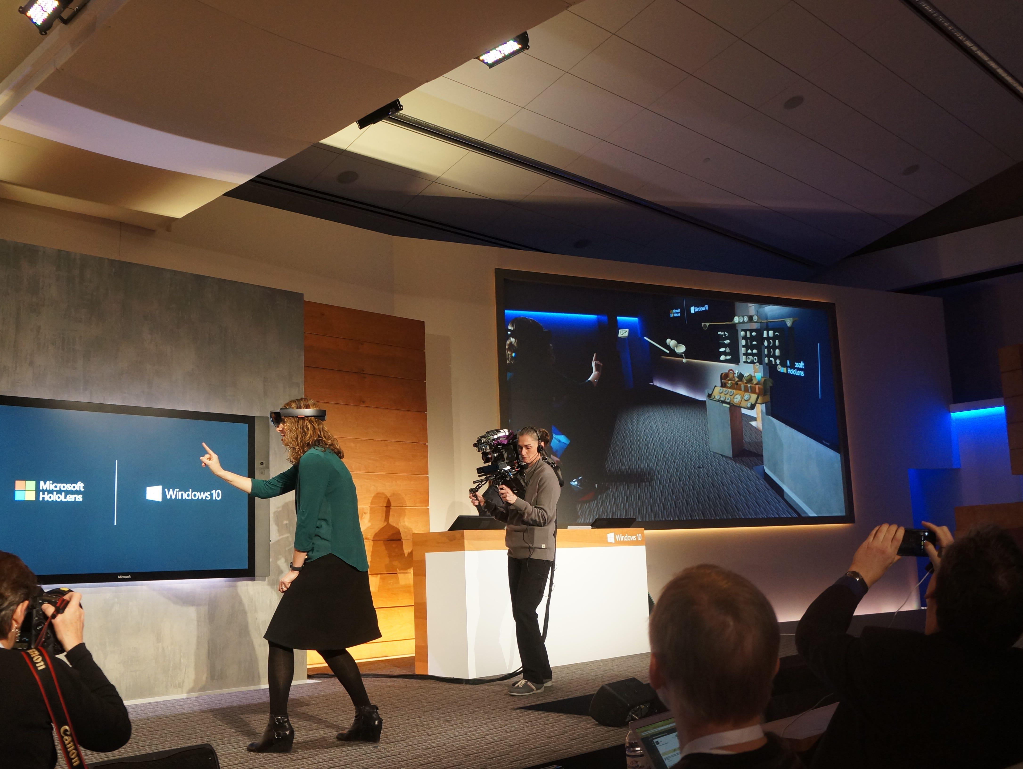 A Microsoft employee demonstrates Microsoft HoloLens.