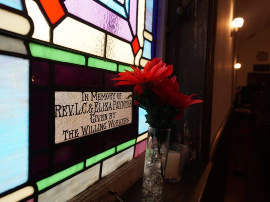 A stained glass window in the John Wesley United Methodist Church in Belltown. A proposal to preserve the church structure as part of a brewpub has some cheering, and others saying it would be sacrilege.