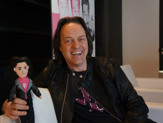 T-Mobile triples net income, beats expectations