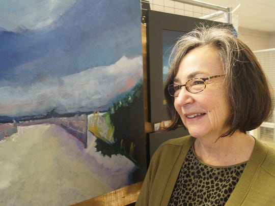 Jean Bowers, an oil painter, talks about her artistic vision at the Milton Arts Guild's winter show on Saturday, Feb. 27, 2016.